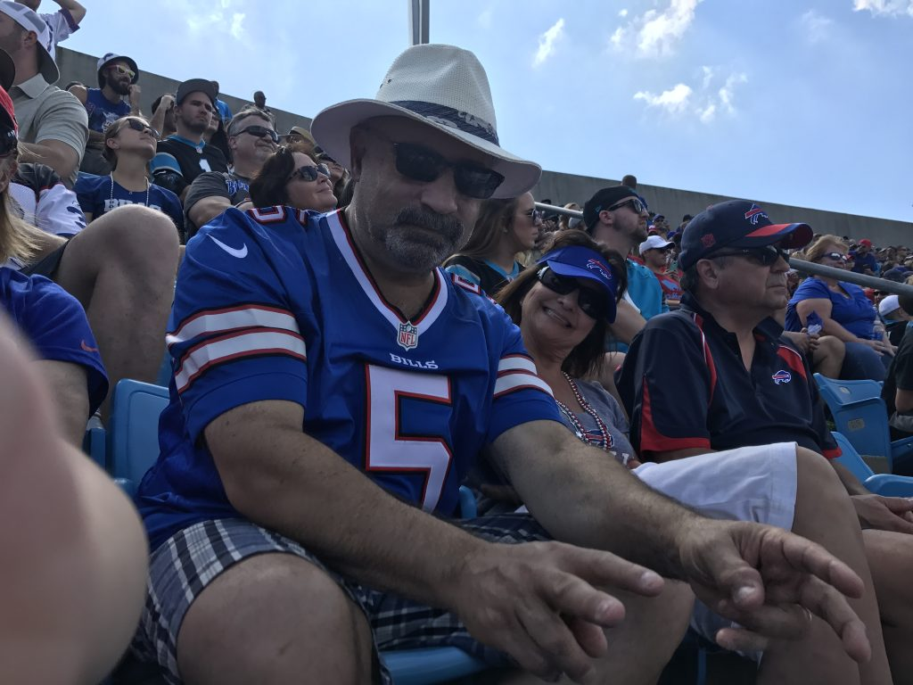 Mick Vetrano wearing a Buffalo Bills jersey and sun hat